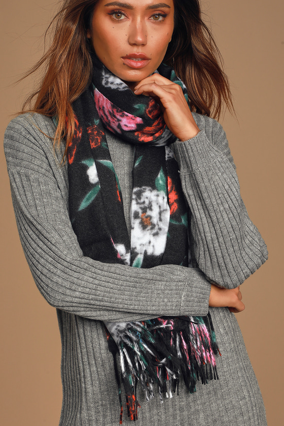 Stay cozy, but make it chic with the Lulus Floral Frills Black Multi Floral Print Blanket Scarf! Soft and fuzzy woven fabric, with a black, pink, blue, green, white, orange, and red floral print, shapes this snuggly oversized scarf, with fun fringe ends. 26. 5\
