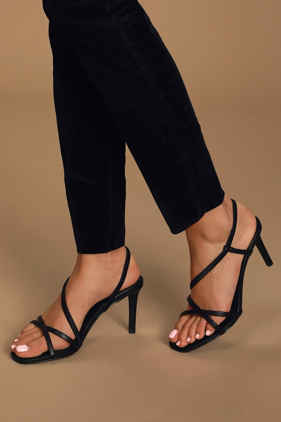 Awaken your inner boss babe in the Lulus Byrdie Black Strappy High Heel Sandals! Vegan leather shapes a sleek single sole silhouette with an open, square-toe upper, framed by crisscrossing toe straps. Elastic strap sprouts from vamp and wraps into a secure slingback, creating an asymmetrical design. 3. 25\