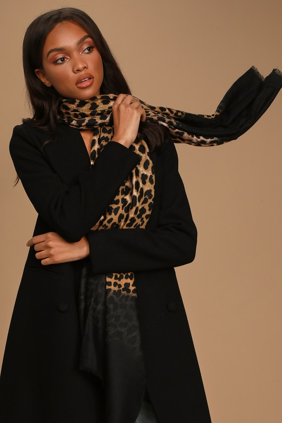 Lulus Exclusive! Whether you live in the concrete jungle or out in the flat plains, the Lulus Gone Wild Brown Leopard Print Oversized Scarf will have you roaring with style! Soft and lightweight woven fabric in a trendy brown leopard print that fades out to black, shapes this trendy, oversized scarf with a raw fringe hem. 36\