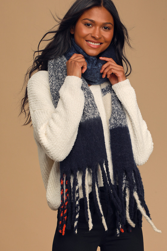 Raise a glass in celebration of how cozy the Lulus Warm Cheers Navy Blue Plaid Oversized Scarf is! Cozy, navy blue woven fabric shapes this oversized fleece scarf with hot pink and blue plaid print and multi-colored fringe. Pair with a turtleneck sweater dress and thigh-high boots to celebrate the season! 90\