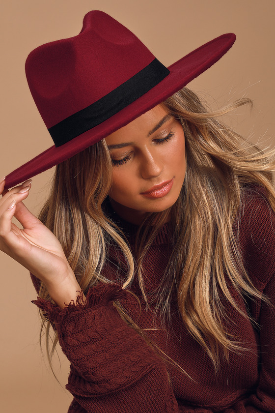 The Lulus Drop the Mic Burgundy Fedora Hat will pair perfectly with all your chic fall looks! Sturdy felted fabric shapes this adorable hat that features a wide brim and black grosgrain ribbon accent at the base. 3. 75\