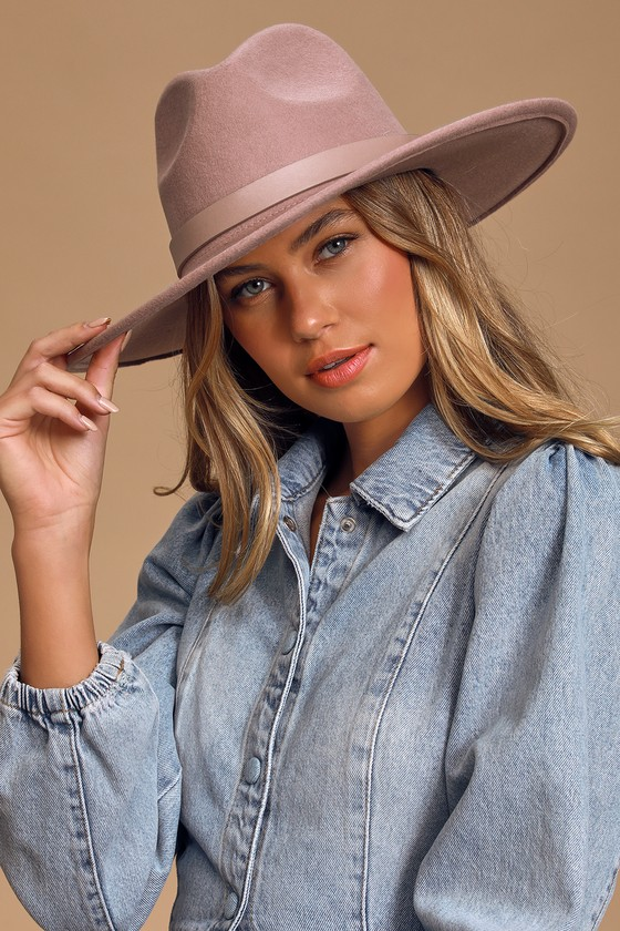 We\'d wear the Lulus How I Wanderlust Mauve Fedora Hat every day if we could! Soft wool forms this highly coveted hat featuring a wide brim and matching vegan leather band accent with a shiny gold stud. Interior drawstring allows for a custom fit. 3. 75\