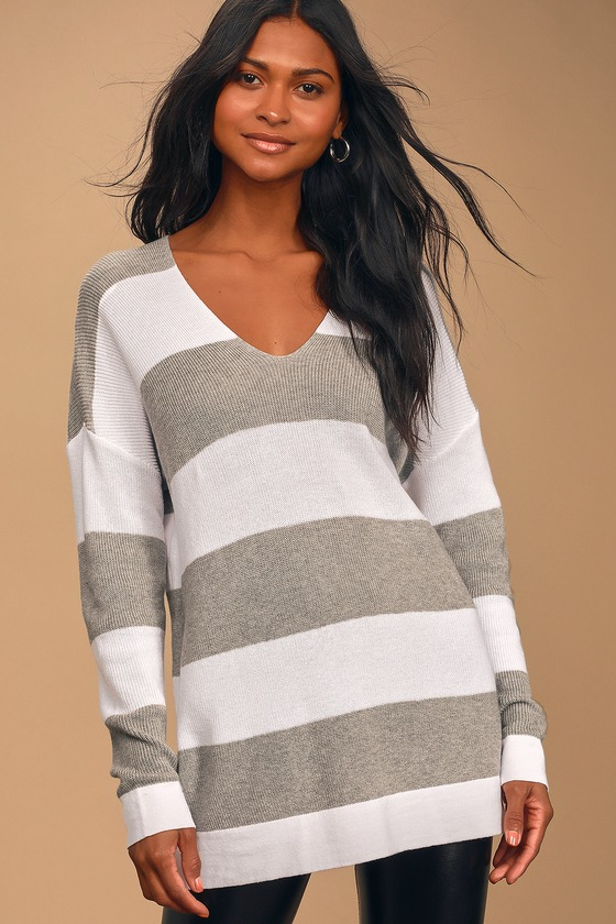 Lulus Exclusive! It\'s no surprise that the Lulus Snow Wonder Grey and White Striped Oversized Sweater is our new go-to! Soft and lightweight knit shapes this essential sweater with fitted long sleeves with drop shoulders, and a V-neckline. The oversized silhouette pairs perfectly with leggings and boots! Fit: This garment fits true to size. Length: Size small measures 28.5\