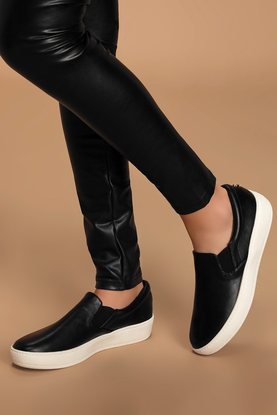 Lulus Exclusive! The Lulus Dylann Black Slip-On Flatform Sneakers are ready for wherever your adventures take you! Sleek vegan leather shapes these cool girl-approved slip-on sneakers with a bit of elastic at the vamp for fit. Gold heart metal logo tag at the heel. 1.5\