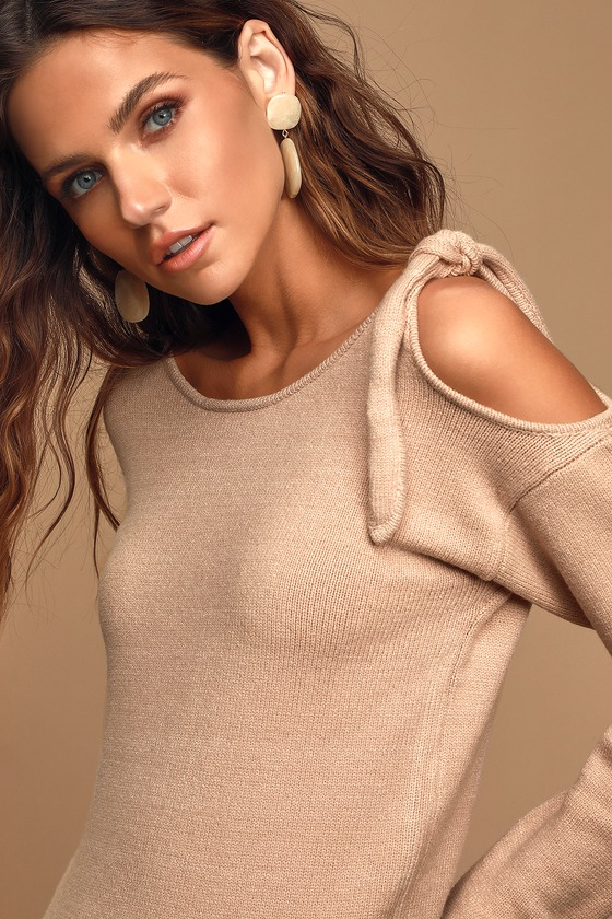 Lulus Exclusive! Let the Lulus Peek-A-Boo Beige Knit Pullover Sweater take you from day to night in style! Cozy knit makes up this adorable sweater that boasts a rounded neckline and fitted bodice, framed by long sleeves. Trendy tie detail and shoulder cutout adds a little something extra to this must-have piece. Ribbed knit trim lines he cuffs and hem. Fit: This garment fits true to size. Length: Size small measures 19.5\