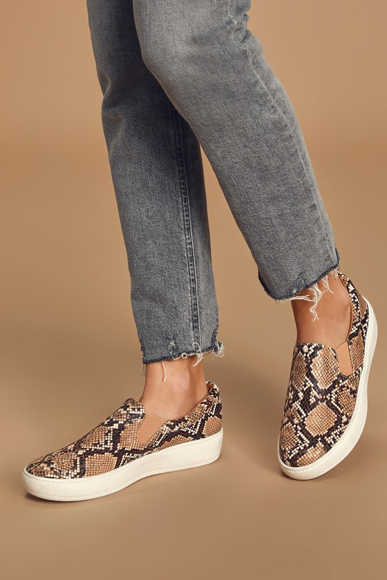 Lulus Exclusive! The Lulus Dylann Tan Snake Slip-On Flatform Sneakers are ready for wherever your adventures take you! Sleek, snake print vegan leather shapes these cool girl-approved slip-on sneakers with a bit of elastic at the vamp for fit. Gold heart tag at the heel. 1.5\