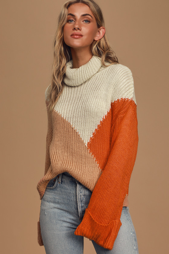 The MINKPINK Snow Doubt About It Cream Multi Colorblock Turtleneck Sweater is guaranteed to keep you cozy all winter long! This cute sweater has a medium-weight ribbed construction and boasts an asymmetrical colorblock pattern in cream, taupe, and orange hues. Flared long sleeves (with rolled cuffs and drop shoulders) frame the cozy turtleneck and oversized bodice to finish the look! Fit: This garment fits true to size. Length: Size small measures 20\