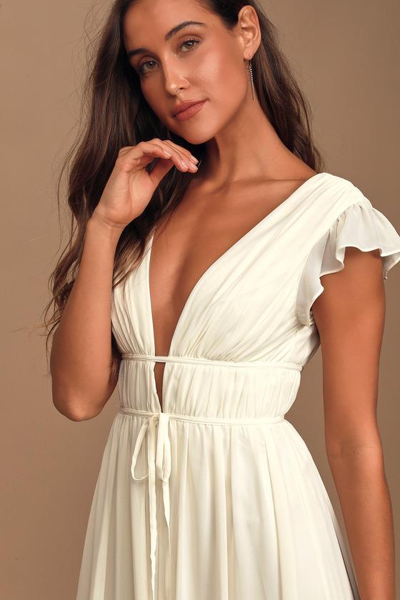 white boho casual maxi dress engagement photos cream long dress for engagement sessions