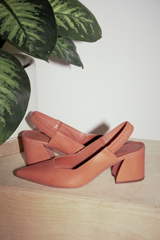 The Lulus Bixby Cognac Vachetta Leather Pointed-Toe Slingback Pumps are sleek and stylish! Smooth, genuine vachetta leather shapes a pointed-toe upper, and classic slingback, with elastic for fit. Flared block heel adds a stylish finishing touch! 2. 75\\\