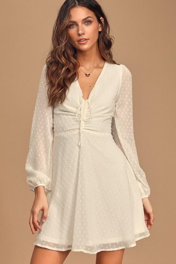 70s Dresses – Disco Dress, Hippie Dress, Wrap Dress Wine and Dine White Swiss Dot Long Sleeve Skater Dress - Lulus $59.00 AT vintagedancer.com