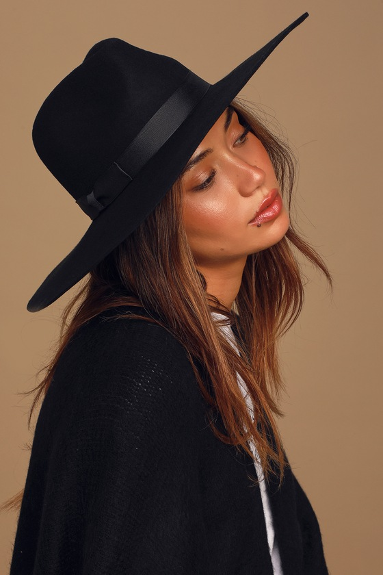 Take your look from cute to complete with the Lack of Color Montana Midnight Muse II Black Wool Wide-Brimmed Fedora Hat! Structured wool constructs this perfectly chic hat with a fedora silhouette, wide-brim, and classic black grosgrain bow ribbon detail. Pair with just about any outfit and watch as the compliments roll in! 4. 5\