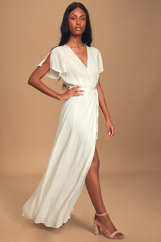 gorgeous white maxi dress for engagement photo shoot engagement dress white photos boho wrap dress