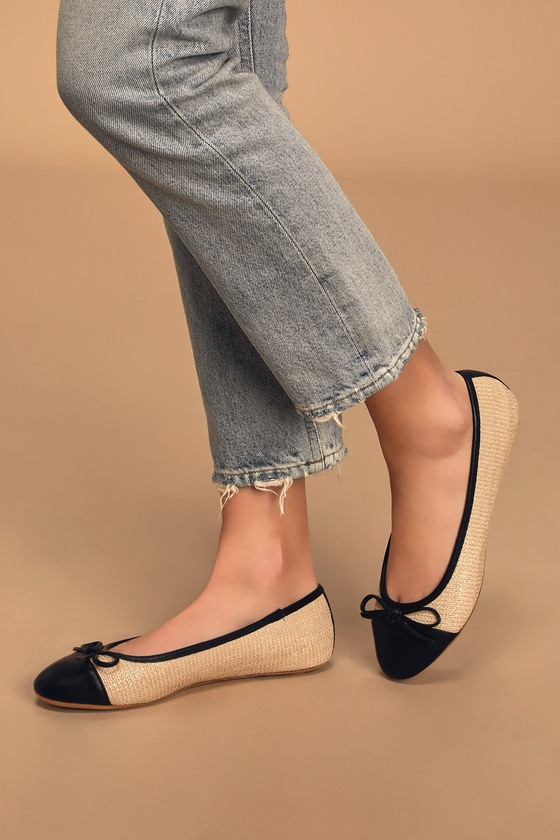 The Imogene Black and Beige Woven Flats can go from the office to happy hour with confidence and style! Woven straw shapes these cute ballet flats with a round cap toe upper, decorative bow on the vamp, and a slip-on silhouette. Contrasting black vegan leather accents the toe, outline, and stripe at the back for a chic finishing touch! Fit: This garment fits true to size. 0. 25\