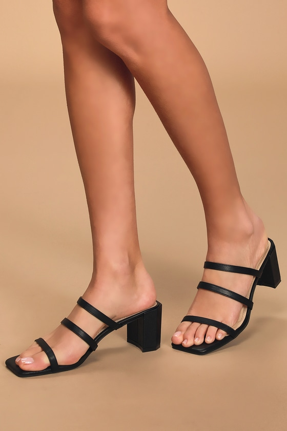 Lulus Exclusive! Walk into any room with confidence when you\\\'re wearing the Lulus Jacie Black High Heel Sandals! Sleek vegan leather shapes these essential sandals that have a squared toe and slide-on silhouette that is accented a trio of slender straps. A chunky half octagon block heel makes a bold and trendy statement! Fit: This garment fits true to size. 2. 5\\\