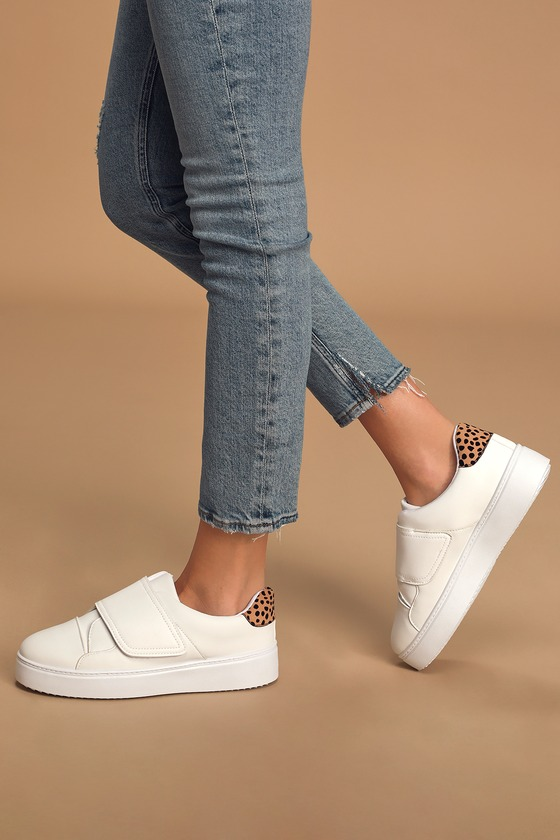 The Bayleigh White Flatform Sneakers are the perfect sneaks you can wear year \\\'round! Sleek vegan leather shapes a rounded toe and classic sneaker design with VELCRO ; closure at the vamp. Vegan suede accent, in a trendy cheetah print, at the heel adds funky flair to these chunky flatform sneakers. Fit: This garment fits true to size. 1. 25\\\