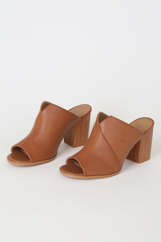 Everyone will be asking you for styling tips after they see you in the Bette Rust Brown Peep-Toe Mules! Sleek vegan leather overlaps to create the peep-toe upper of these cute heels with a notched collar and chunky block heel. Slide-on design. Fit: This garment fits true to size. 3\