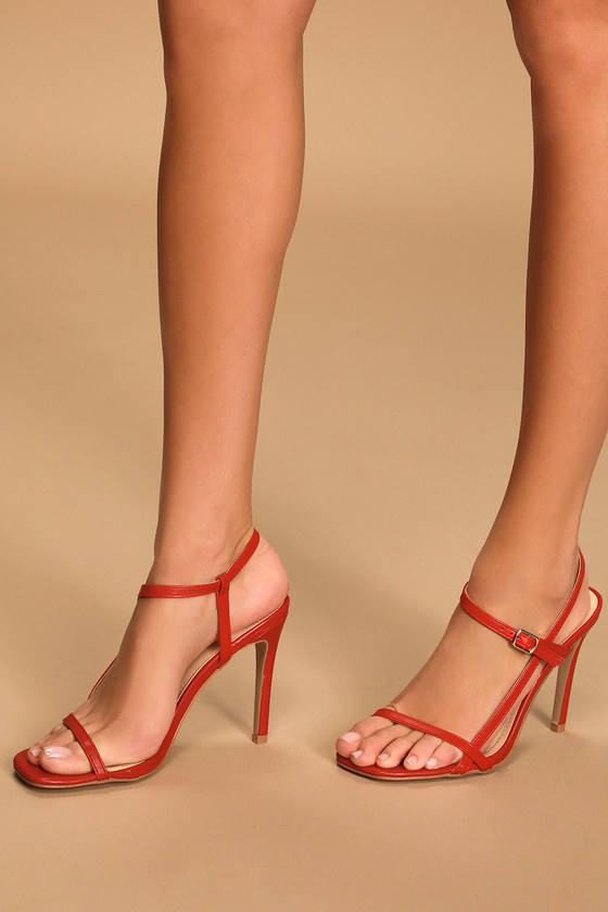 Lulus Exclusive! Dip your toe into the barely-there shoe trend with the Lulus Vacie Red High Heel Sandals! Vegan leather covers a square toe, slender toe strap, and matching long straps that start at the toe bed and continues into an adjustable strap that wraps and secure around the ankle via a shiny silver buckle. Fit: This garment fits true to size. 4. 5\