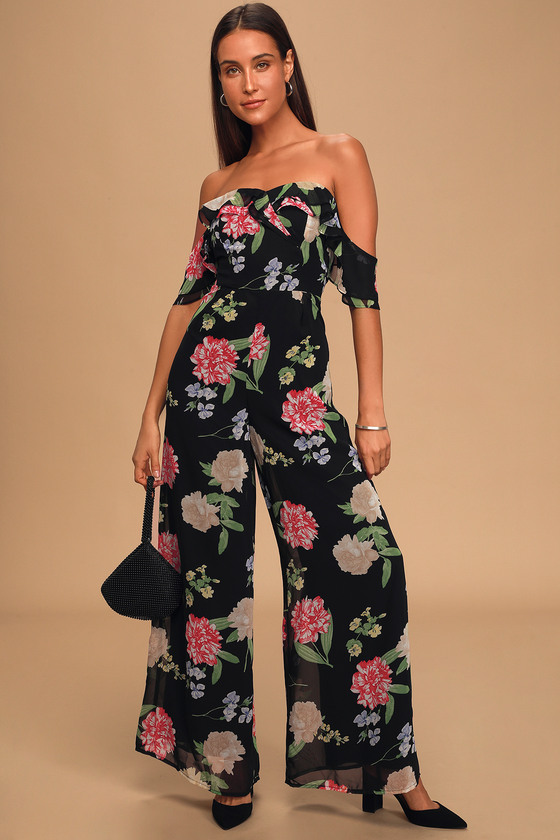 Lulus Exclusive! We are blown away by perfect the Lulus Florally Impressed Black Floral Print Off-the-Shoulder Jumpsuit is! Lightweight woven fabric, in a black, red, green, and cream floral print, shapes this trendy jumpsuit. Tiered ruffles overlap slightly as they create an off-the-shoulder neckline (with hidden no-slip strips) and flouncy straps. Fitted high waist, with pleats that create an overlapping look, rests atop wide-cut pant legs with a relaxed fit. Hidden back zipper/clasp. Fit: This garment fits true to size. Length: Floor length. Size small measures 52\\\