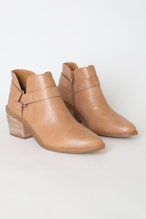 Stomp around and strut your stuff in the Report Orleana Tan Pointed-Toe Ankle Booties! Smooth faux leather forms these trendy booties with a pointed-toe upper, notched collar, and decorative silver triangle ring that connects two strap details. 3\