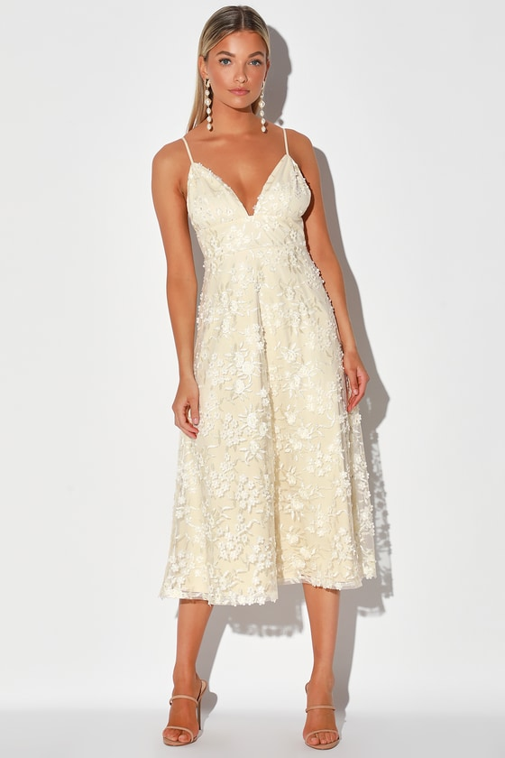 Lulus Exclusive! Enter the room with a grand entrance in the Lulus Flourishing Kiss Cream Floral Embroidered Floral Lace Midi Dress, and be prepared for all the love! Sheer mesh, with lovely three-dimensional floral embroidery, atop a cream knit lining, creates a V-neckline that falls from adjustable spaghetti straps. A princess-seamed bodice sits atop a set-in waist and full A-line midi skirt. Hidden back zipper/clasp. Fit: This garment fits true to size. Length: Mid-calf length. Size small measures 41\