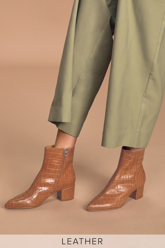 Everyone has a favorite ankle boot, and these just became ours! The Dolce Vita Bel Cognac Crocodile Print Leather Ankle Booties are composed of crocodile-embossed genuine leather that shapes a pointed toe and an ankle-high shaft with a hidden 6.5\\\
