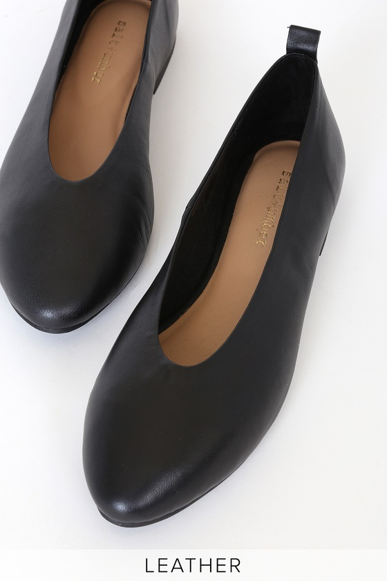 Total comfort meets trendy chic with the Salt + Umber Raja Black Leather Flats! Buttery soft and flexible, lightly textured genuine leather creates these perfectly minimal flats with an almond toe, a narrow-cut collar, and a pull-tab at back for easy off-and-on. Cushioned insole makes these a go-to for every day wear! Slip-on design. Available in whole sizes only. Fit: This garment fits true to size. 0. 5\\\