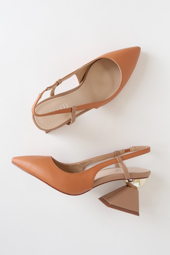 Make a statement in any outfit when you\'re wearing the RAID Jasmine Dark Coral Pointed-Toe Slingback Pumps! These cute pumps are shaped from sleek vegan leather, with a cognac hue, and feature a pointed toe upper and slingback silhouette with supportive side straps and a bit of elastic. A unique shiny gold sphere accents the contrasting beige pyramid block heel to create a stunning finishing touch. Available in Euro sizes only. Fit: This garment fits true to size. 3. 25\
