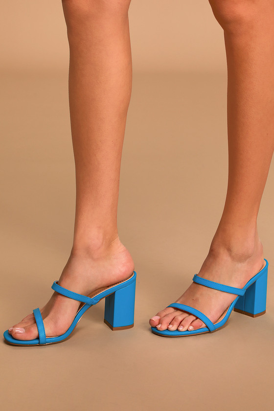 Lulus Exclusive! Easily elevate any outfit with the Lulus Ariellie Blue High Heel Sandals! Sleek vegan leather shapes these trendy heels that have an open-toe upper and slide-on design that\'s accented by slender straps at the toe and vamp. Chunky block heel makes these the perfect all-day sandal! Fit: This garment fits true to size. 3. 5\