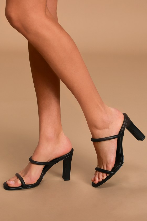 Lulus Exclusive! Channel your inner fashionista and step out of the box with the Lulus Xenya Black High Heel Sandals! Sleek vegan leather shapes a square toe upper with a puffed toe strap and matching elasticized vamp strap all atop a classic block high heel. Fit: This garment fits true to size. 3. 5\