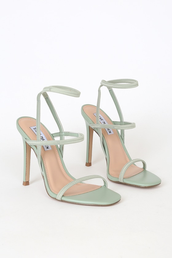 Slip on the Steve Madden Nectur Mint High Heel Sandals for an instant confidence boost! A slender toe band tops a strappy vamp and matching ankle strap, all shaped by comfortable stretchy elastic straps! Pair with an LBD and sunnies for a classic, sexy look! Fit: This garment fits true to size. 4. 25\\\