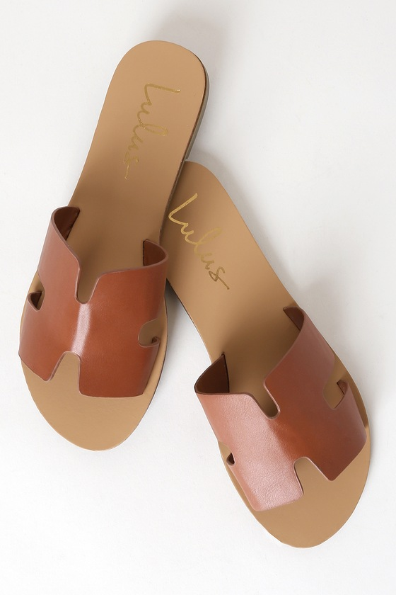 Lulus Exclusive! Add the Lulus Saxon Tan Slide Sandals to your ever-growing sandal collection for a touch of flair and style! Sleek vegan leather creates a wide, cutout vamp strap, notched detail, and an open toe upper atop a 1.25\\\