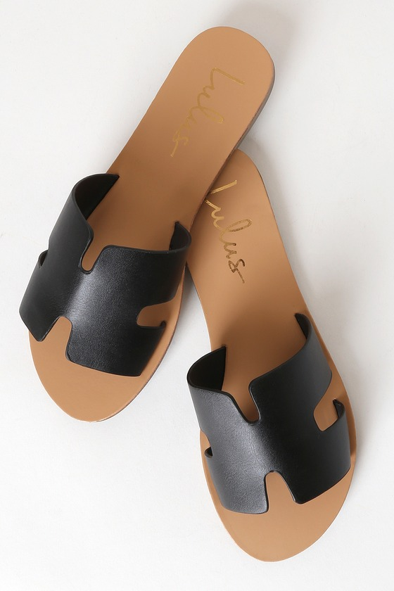 Lulus Exclusive! Add the Lulus Saxon Black Slide Sandals to your ever-growing sandal collection for a touch of flair and style! Sleek vegan leather creates a wide, cutout vamp strap, notched detail, and an open toe upper atop a 1.25\\\