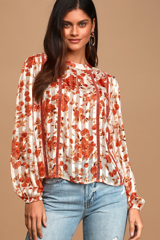 Lulus Exclusive! The Lulus Floral the Best Orange Floral Print Sheer Long Sleeve Top is the creme de la creme of fancy blouses! Woven fabric, with a sheer and satiny tonal stripe and orange floral print throughout, is punctuated with panels of pierced embroidery as it shapes this eye-catching blouse with a high mock neckline, long sleeve with elastic cuffs, and a billowing bodice with a keyhole cutout at the center. Back keyhole with top button. Fit: This garment fits true to size. Length:  Size small measures 23\\\