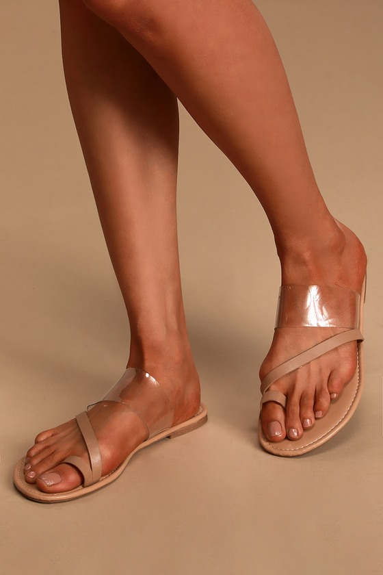 The Lulus Avena Nude Flat Sandals make your farmer\\\'s market trek extra cute! A wide, clear vinyl band, slender vegan leather band, and matching toe loop make up these minimalist-chic sandals. Slide-on design. Fit: This garment fits true to size. 0. 25\\\