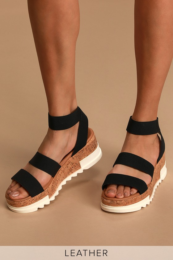 For a shoe that is as unique as you slip into the Steve Madden Bandi Black Platform Sandals! A stretchy fabric upper with matching ankle strap rests atop a hybrid cork and rubber platform lug sole for a standout design. 1.5\\\