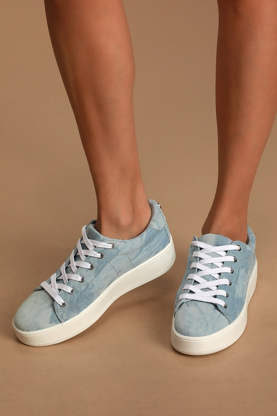 Girly and sporty style combine to form the Steve Madden Bertie Denim Fabric Sneakers! Faded light wash denim covers these flatform sneakers with contrasting white laces. 1.5\\\