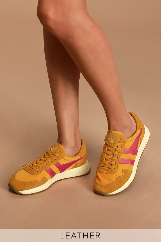 The Gola Vancouver Sun Fuchsia Sneakers are a modern twist on one of your favorite throwbacks! Sleek nylon and genuine suede leather, in a sunny yellow hue, come together to shape these cute sneaks that have a lace-up upper and contrasting fuchsia stripes and wingflash. Phylon midsole and cleated outsole add to the retro vibes of these cool sneaks! Branded detail at outstep and tongue. 1.5\\\