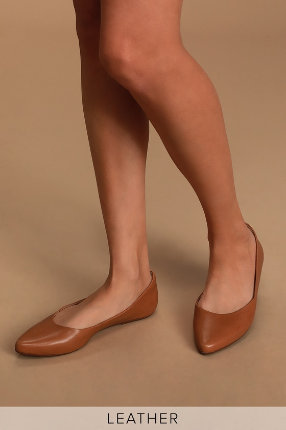 You can\\\'t go wrong with the classic style of the Lulus Holly Leather Cognac Pointed Toe Flats! Upgrade your everyday flats with these luxe genuine leather flats with a soft, pointed toe design and low-cut collar. Slip-on design. Light cushioning at the heel ensures comfort from the very first wear! Fit: This garment fits true to size. 0. 25\\\