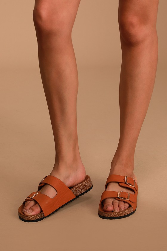 We hope you\\\'re ready for your next adventure! The Carmella Tan Buckled Slide Sandals have sturdy vegan leather straps and adjustable gold buckles for a custom fit. Composite cork insole measures 1\\\
