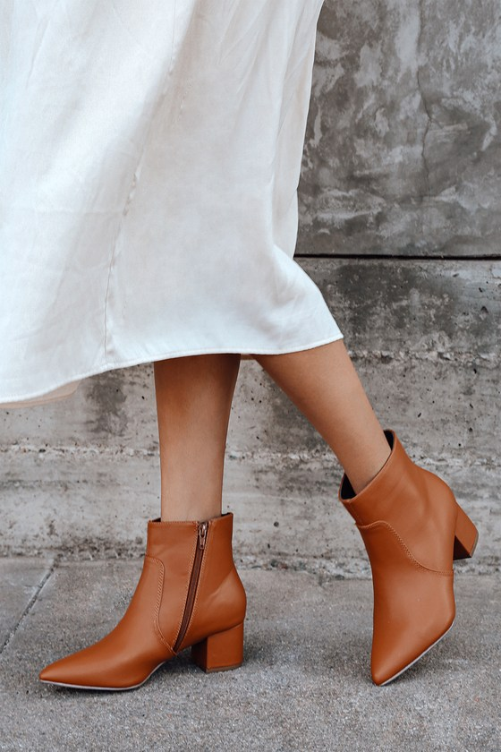 The Lulus Sofia Tan Pointed Toe Ankle Booties are a wear-with-anything new favorite! Smooth vegan leather shapes a pointed toe upper, and ankle high shaft with a 6\\\