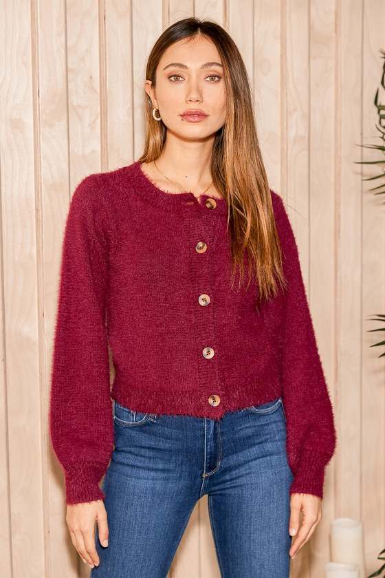 No matter how cold the day gets, the Lulus Bonjour to You Burgundy Eyelash Knit Cardigan Sweater is here to greet you with open arms! Fuzzy eyelash knit shapes this cute little cardi with a round neckline, long balloon sleeves, and a slightly cropped bodice. Marbled, functional button placket at front. Ribbed knit accents at the cuffs and hem. Fit: This garment fits true to size. Length:  Size small measures 19\\\