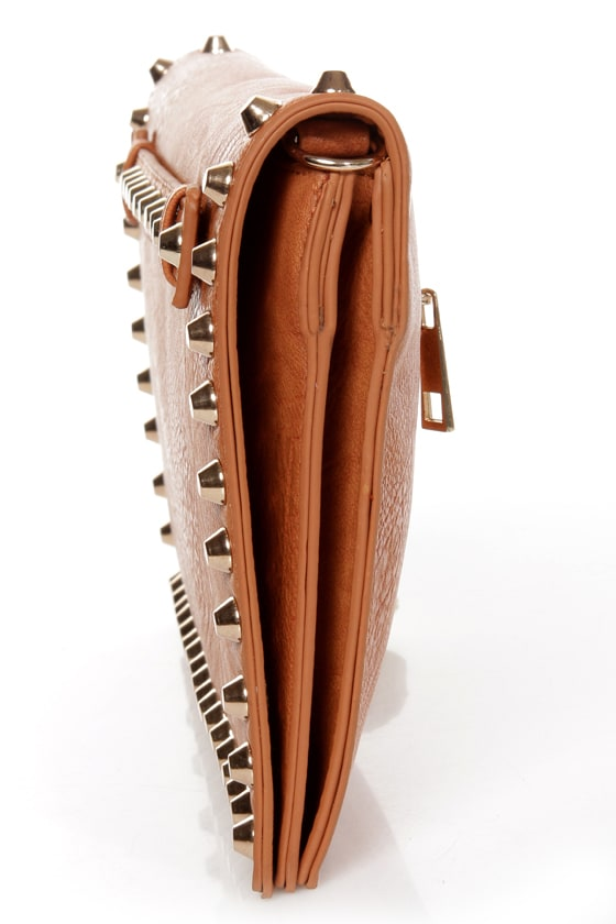 Surrounded by Studs Tan Studded Clutch at Lulus.com!
