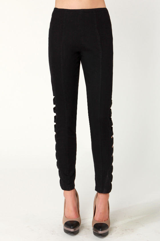 Peripheral Perfection Black Cutout Cropped Pants at Lulus.com!