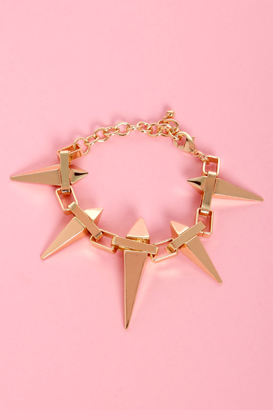 Stake-r Shock Gold Spike Bracelet at Lulus.com!