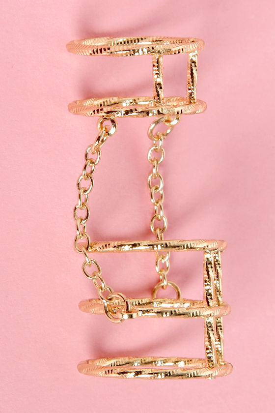 Cage-erator Gold Knuckle Ring at Lulus.com!