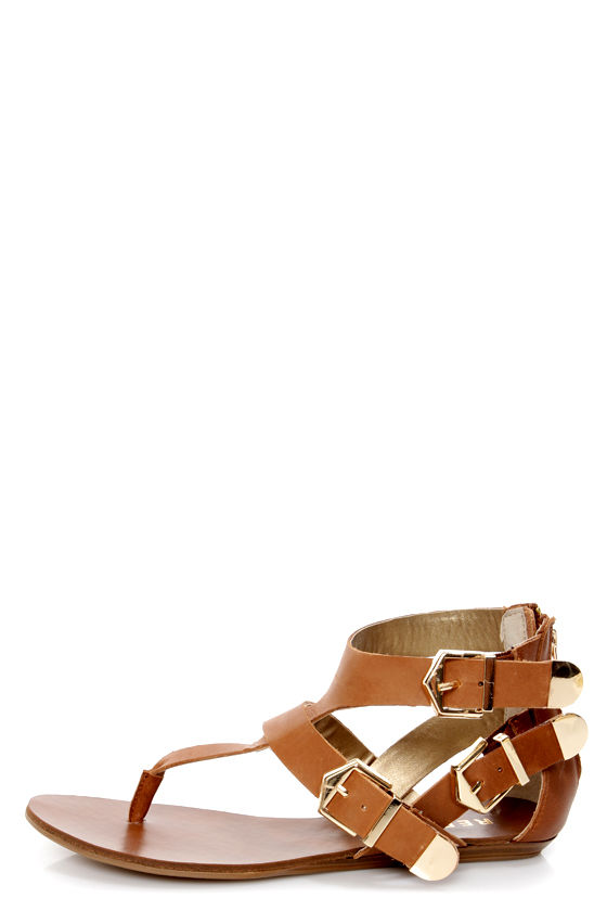 Report Jamieson Tan Leather Buckled Gladiator Sandals at Lulus.com!