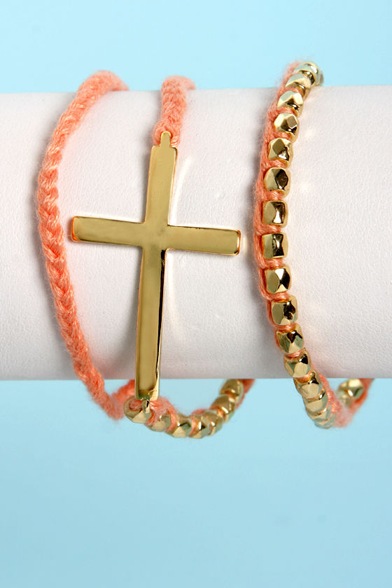 Who's the Cross Peach and Gold Wrap Bracelet at Lulus.com!