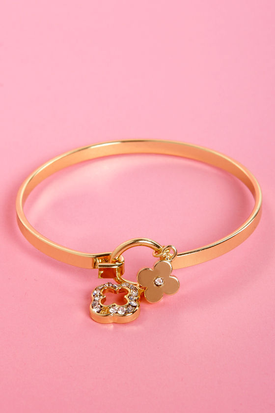 On the Arm-y Now Gold Charm Bracelet at Lulus.com!
