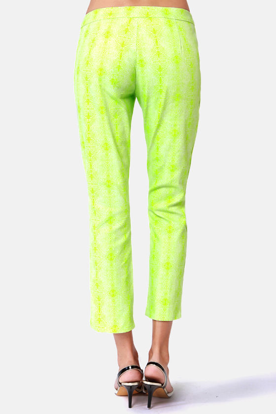 Get it Bright Neon Green Snake Print Pants at Lulus.com!
