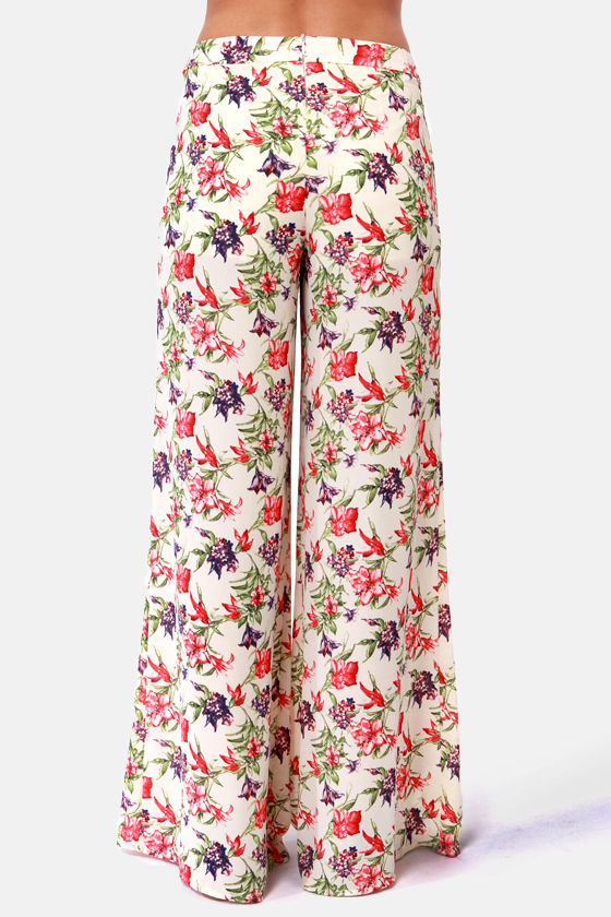 What in Carnation Wide-Leg Cream Floral Print Pants at Lulus.com!